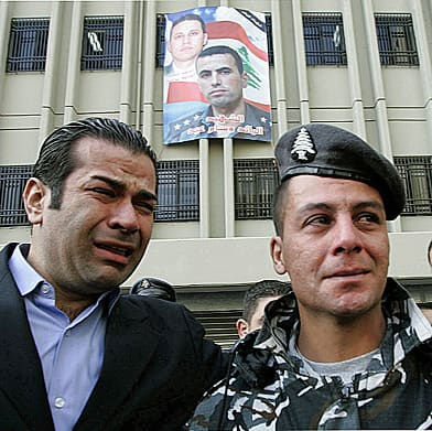 Lebanese policemen break down at the funeral of Capt. Wissam Eid, 31, one of the country's top terrorism investigators. Eid was killed by a car bomb on Jan. 25, 2008, along with his bodyguard and three others, shortly after agreeing to help UN investigators. (Hussein Malla/Associated Press)