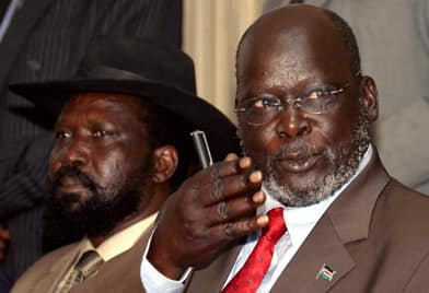 SPLA leader John Garang, right, flanked by deputy commander Salva Kiir Mayardit, answers a question during a press conference in Kenya's capital, Nairobi, on Jan. 8, 2005. The next day, Garang signed the peace agreement that ended 21 years of civil war. Garang died in a helicopter crash in July 2005. Kiir Mayardit is now president of Southern Sudan.