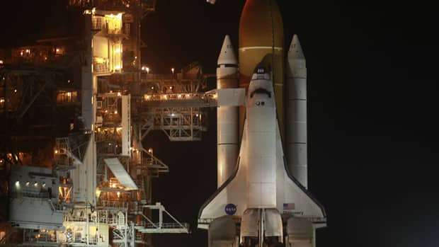 The space shuttle Discovery is prepared for launch to the Interational Space Station, its final mission on a mission to the International Space Station.