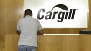 An employee of the American food giant Cargill Inc. stands next to the company logo. Canadian Kexue Huang stole a key component to make a new food product from the company and gave it to a student in China.