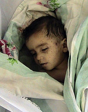 This image, known simply as Houla3, was provided by the Shaam News Network and purports to show a dead child following a Syrian government assault on the city of Houla on May 25, which left over 100 people, most of them women and children, dead.