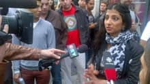 A witness talks to reporters.
