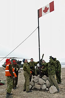 Canadian Forces Northern Area troops raise a Canadian flag on Hans Island, Nunavut, on July 13, 2005.