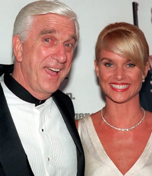 Canadian actor Leslie Nielsen, seen in this 1996 photo with Nicollette Sheridan at the premiere of Spy Hard, died Sunday at age 84.