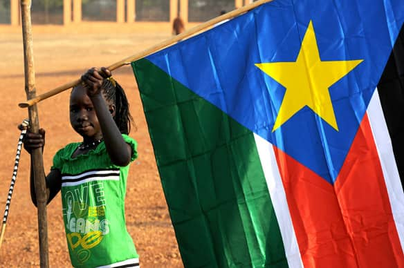 A girl holds a Southern Sudan flag during the announcement of the preliminary results of the independence referendum on Jan. 30. Almost 99 per cent of voters in the south opted to split from the north.
