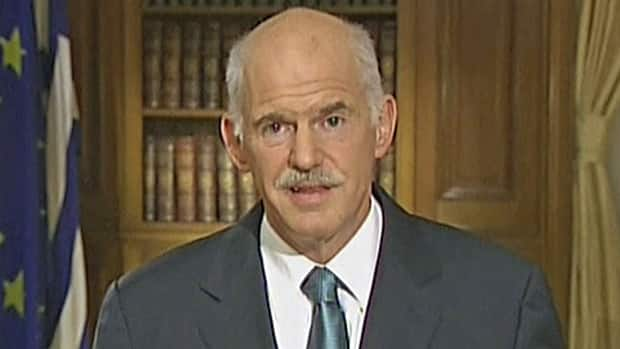 George Papandreou, shown addressing Greeks in TV on Wednesday, said Thursday he would stay on as prime minister and face down opponents within his own party.