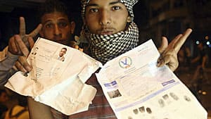 An Egyptian protester holds documents he snatched from the Israeli Embassy in Cairo early Saturdaywhile hundreds of people demonstraated outside the building.