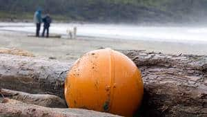 Ocean debris believed to be from Japan is posed for a photograph on Long Beach in Tofino, B.C.