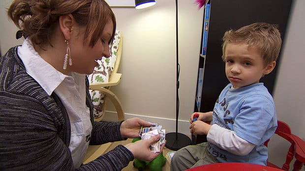 Finn's mom Christine Long works at home with him every day, because daily speech therapy is out of reach. She said she plans to study how to do it herself.