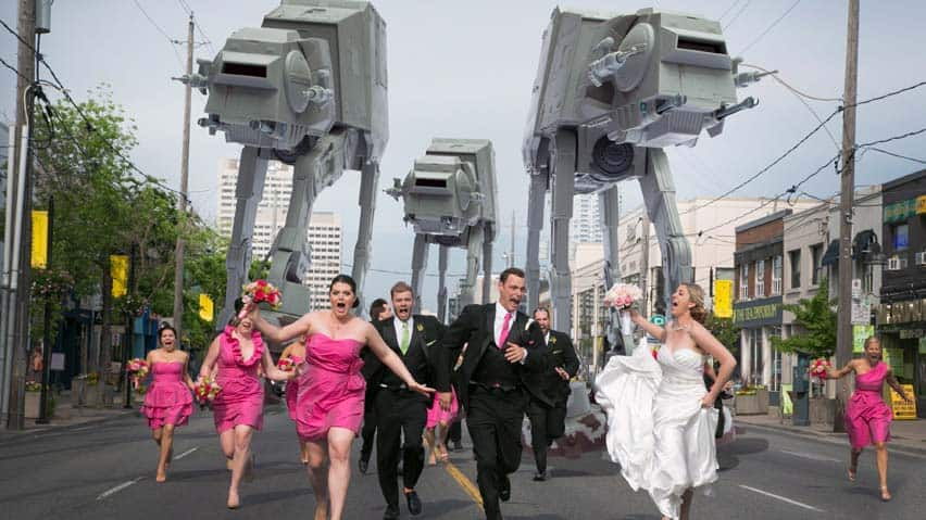 A Toronto couple and their wedding party being chased by the iconic All-Terrain Armored Transport vehicles from The Empire Strikes Back movie.