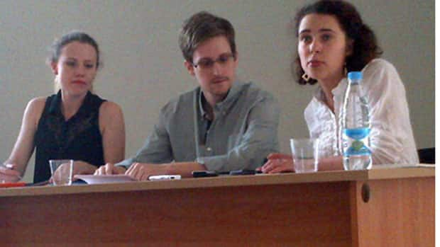 National Security Agency leaker Edward Snowden met with human rights groups Friday and said he plans to seek asylum in Russia until he gets clearance to travel to Latin American countries that have offered him asylum. Snowden is wanted on espionage charges for divulging details of secret U.S. surveillance programs.