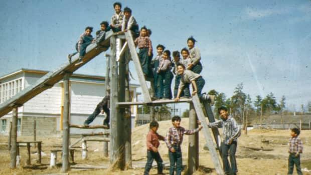 Children on the playground at Cecilia Jeffrey Indian Residential School in Kenora circa 1957. Newly released documents include a report on the