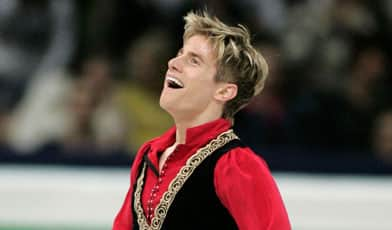 Jeff Buttle reacts after skating a personal-best program to take the men's world title.
