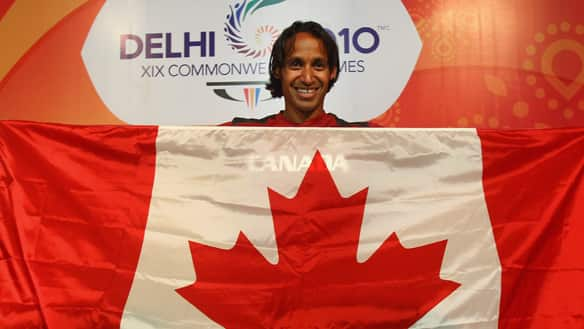 Canadian team flag-bearer Ken Pereira poses for media during a team press conference at the main press centre on Saturday in New Delhi.