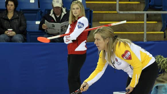 Team Canada skip Jennifer Jones, left, peers over at Manitoba skip Cathy Overton-Clapham lining up a shot at the Hearts.