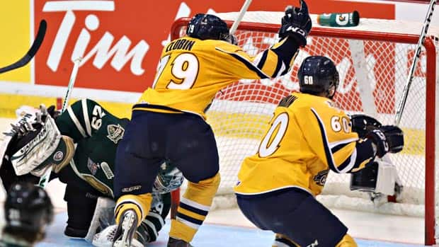 Anton Zlobin, centre, scores his first goal Sunday for Shawinigan against London.