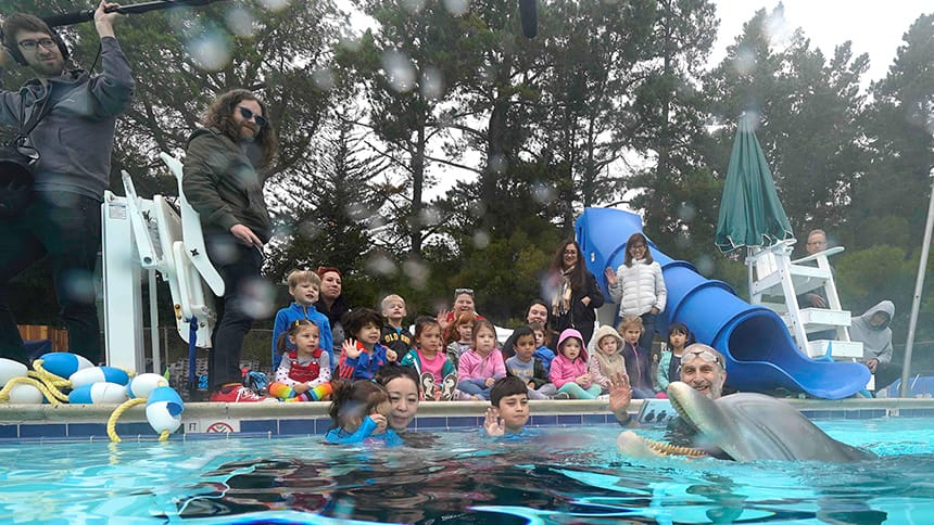 A group of kids and families testing the prototype in a pool.