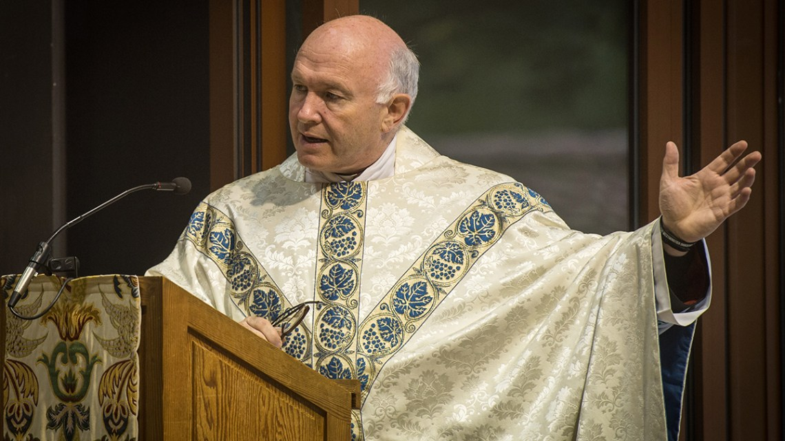 Mgr Armitage speaks at lectern