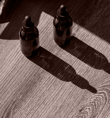 two bottles of cannabidiol tincture bottles