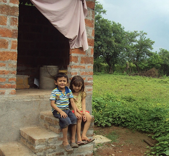 Photo of two kids sitting on porch steps