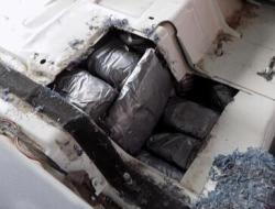 A combination of drugs was found in the floorboard of a smuggling vehicle