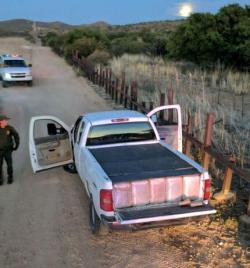 Agents in Douglas, Ariz. seized more than 1,800 pounds of marijuana after stopping a truck that had crossed illegally, east of town