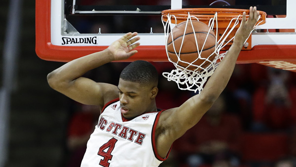 North Carolina State's Dennis Smith Jr. (4) dunks against Virginia Tech during the second half of an NCAA college basketball game in Raleigh, N_316553