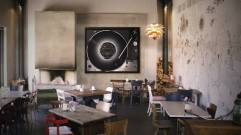 Kai Schaefer artwork, photo of a vinyl record and turntable hanging on a wall