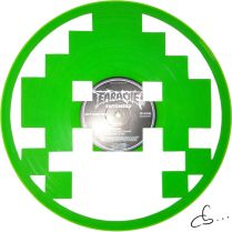 green alien from the video game space invaders made out from vinyl record