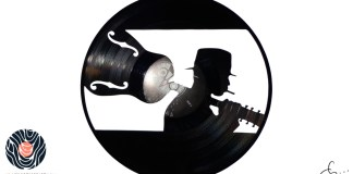 handmade vinyl record art by cb... - Blues Man with his guitar on his back