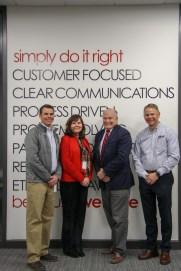 Left to right: Trevor Stohr, President; Michelle Boczek, Director of Economic Development; Mayor Dennis Clough; Jeff Stohr, President