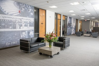 Graphics of our organization's history welcome guests into the office. They help tell our story.