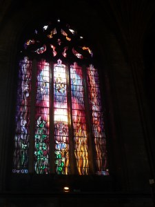 A beautiful modern stained glass window next to the organ case. The upper blue part of the window portrays organ pipes and the Holy Spirit descending. Yes! Organ music is the music of God!