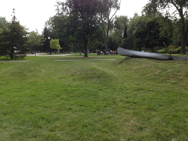 Photo of a canoe on grass.