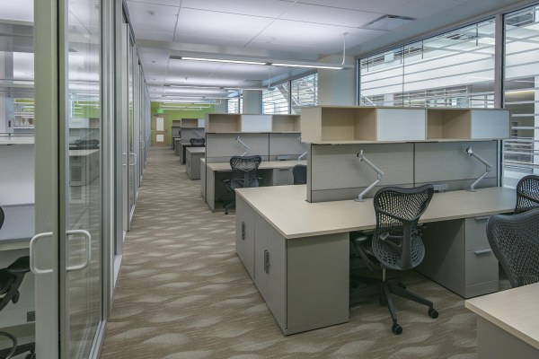 11office interior with rows of desks and chairs
