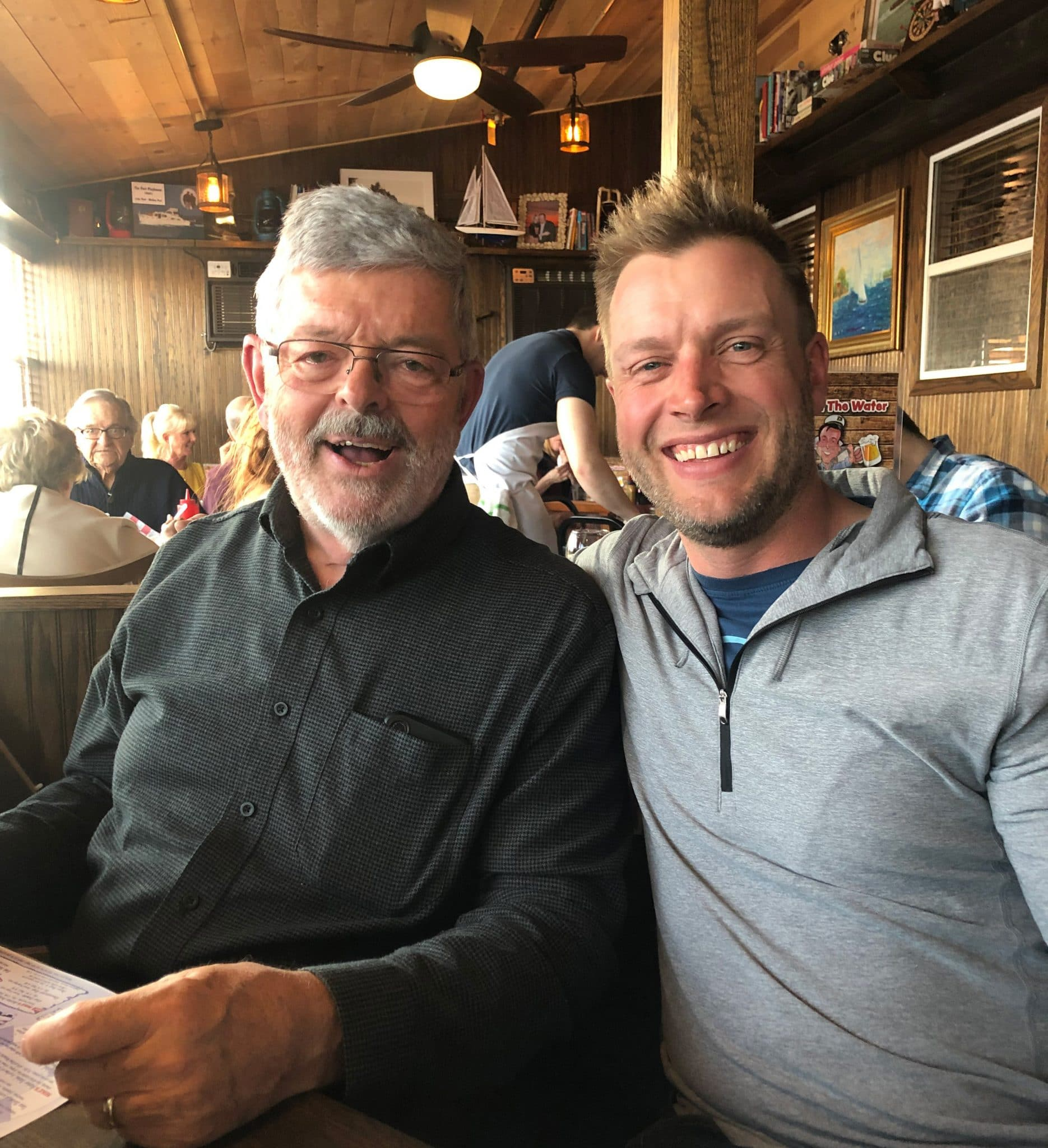 Doug Moody with son in restaurant