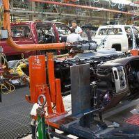 men working on factory line for trucks