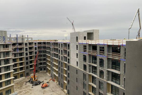 11Zen City apartments unfinished brick exterior with three cranes
