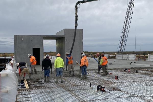 11construction workers lay concrete framing at Zen City apartments