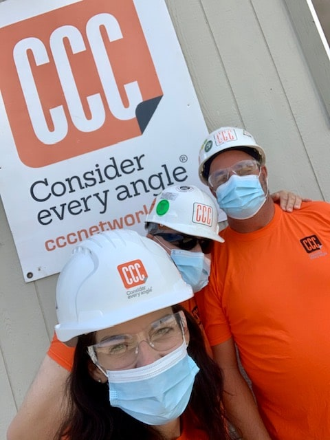 selfie of workers in white CCC hats