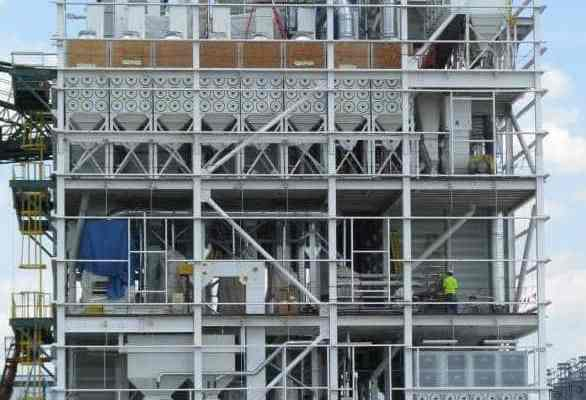 white scaffolding with exposed machinery