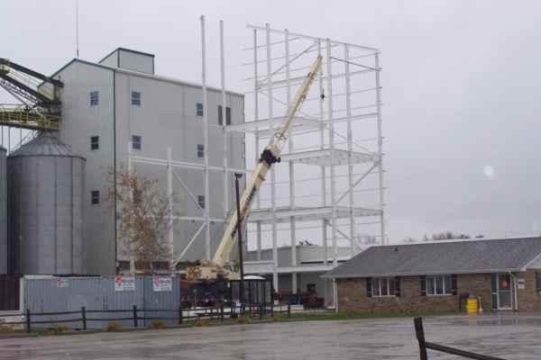 11metal scaffolding next to parking lot