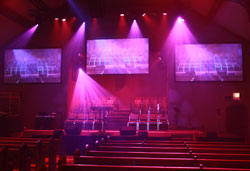 Example of church stage lighting fixtures mounted over the top of the stage
