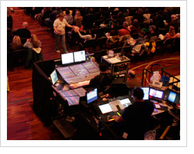 Image of a sound and video tech booth at a large church