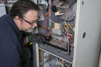 a technician working on heating repair in mount pleasant