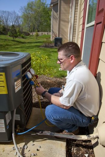 technician installing ac unit