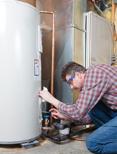 water heater maintenance by the technician mount pleasant