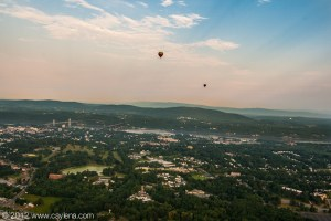 Balloons flying over the Hudson River and Poughkeepsie during the Dutchess County Regional Chamber of Commerce's Balloon Festival in Poughkeepsie, NY. (July 7, 2012)