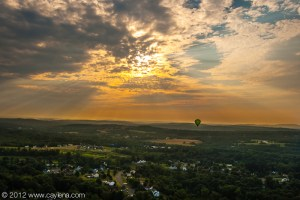 A Lone balloon flies into the dawn over Poughkeepsie. (July 7, 2012)
