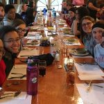 Students gather for dinner after training